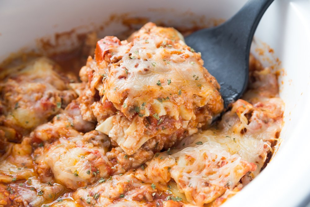Grandma's Crockpot Lasagna - Family Fresh Meals Recipe - Scooping out a slice of lasagna