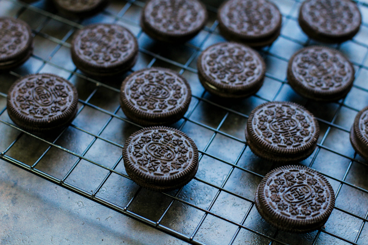 Spooky Halloween Oreos - Oreo cookies laid out on a drying rack