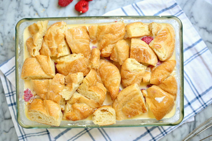 Raspberry Cheesecake Breakfast Bake - Second layer of bread pieces and egg mixture poured into baking dish