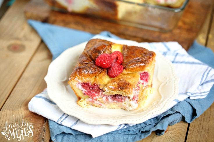 Raspberry Cheesecake Breakfast Bake - slice of breakfast casserole on a white plate
