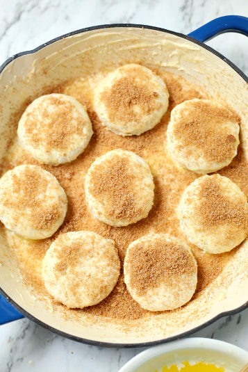 Skillet Apple Pie Dessert Biscuits - biscuits in a prepared skillet topped with cinnamon sugar
