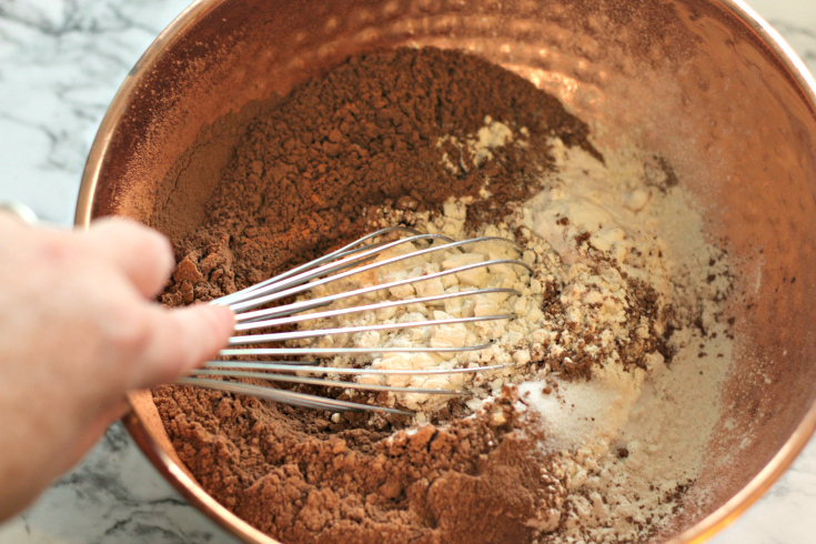 Sour Cream Chocolate Cake - Mixing dry ingredients in a bowl with whisk