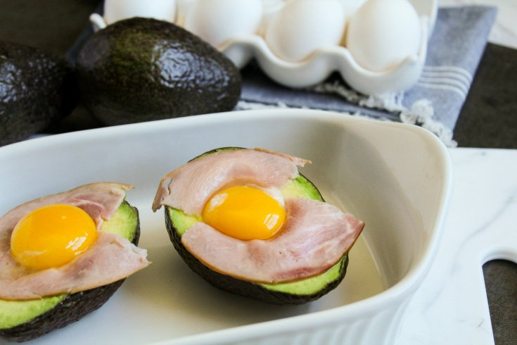 Avocado Egg Bake - egg filled avocados placed in a baking dish