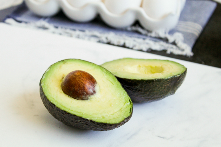Avocado Egg Bites - Avocado sliced in half- Family Fresh Meals