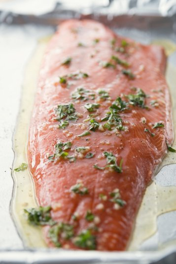 Honey Baked Salmon - Melted butter and seasonings poured over salmon