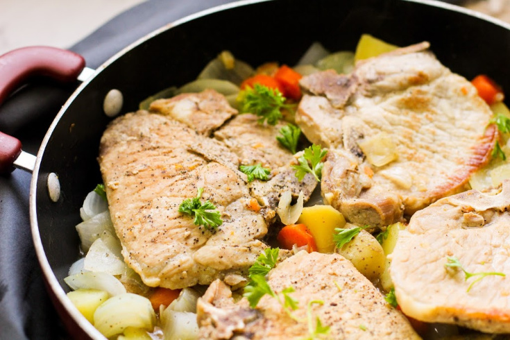 One Pot Pork Chops and Vegetables - cooked pork chops on bed of chopped vegetables