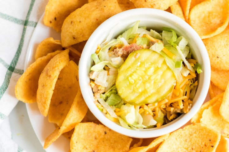 Bacon Cheeseburger Dip - Dip served in a small white dish and corn chips
