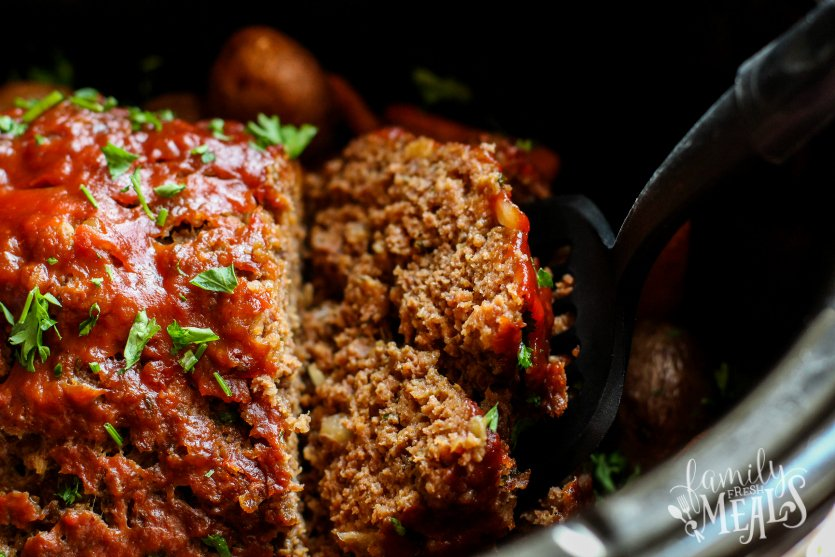 Easy Crockpot Meatloaf Dinner - serving a slice of meat loaf - Family Fresh Meals
