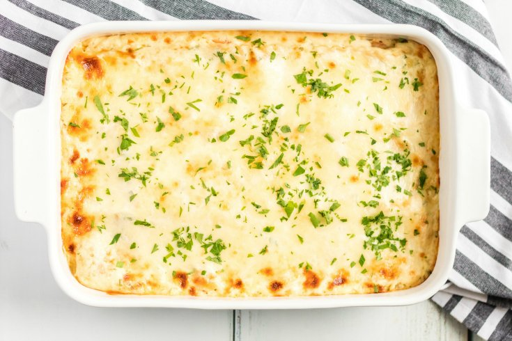 Easy Seafood Lasagna - Baked until cheese is golden and topped with parsley - Family Fresh Meals
