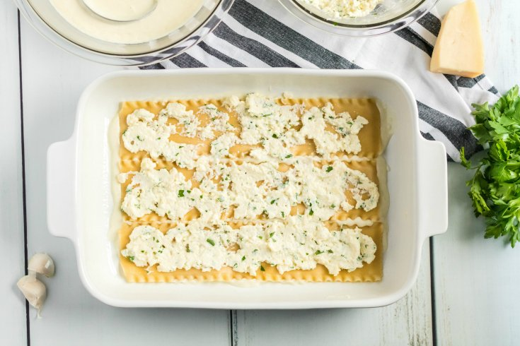 Easy Seafood Lasagna - Cheese mixture placed on top of noodles - Family Fresh Meals