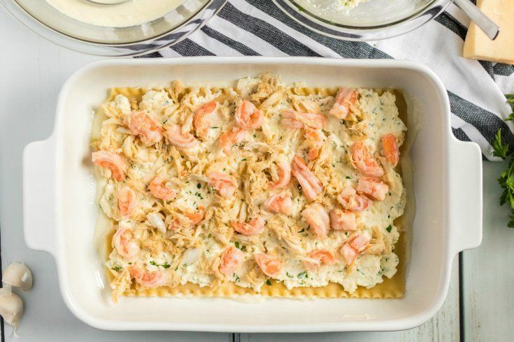 Easy Seafood Lasagna - crab and shrimp placed on top of cheese mixture - Family Fresh Meals