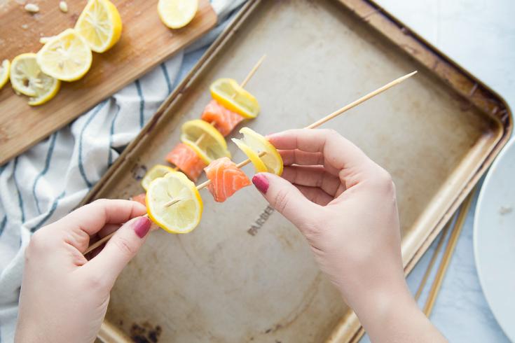 Lemon Salmon Kabobs - How to make salmon kabobs - placing lemon and salmon on kabob stick