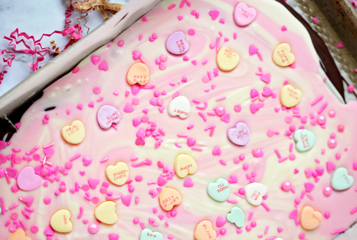 Valentine's Day Chocolate Bark - Conversation hearts and sprinkles on top of melted candy melts.