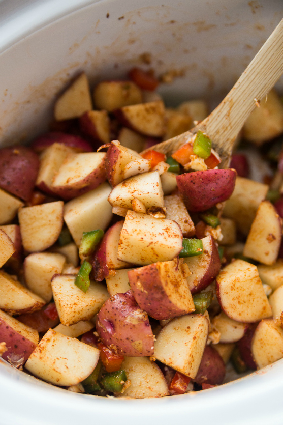 Crockpot Country Potatoes Recipe -Stir potatoes peppers and onions in slow cooker - Family Fresh Meals