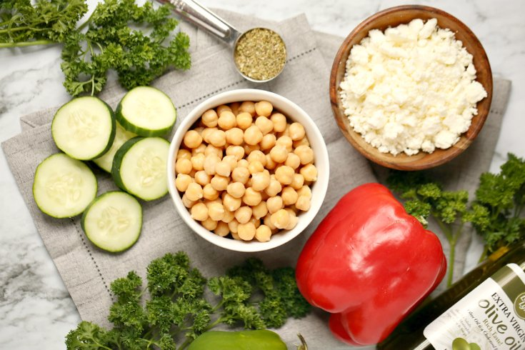 Cucumber Chickpea Salad - Ingredients on counter chickpeas, cheese, bell pepper, cucumbers, olive oil, seasoning - Family Fresh Meals