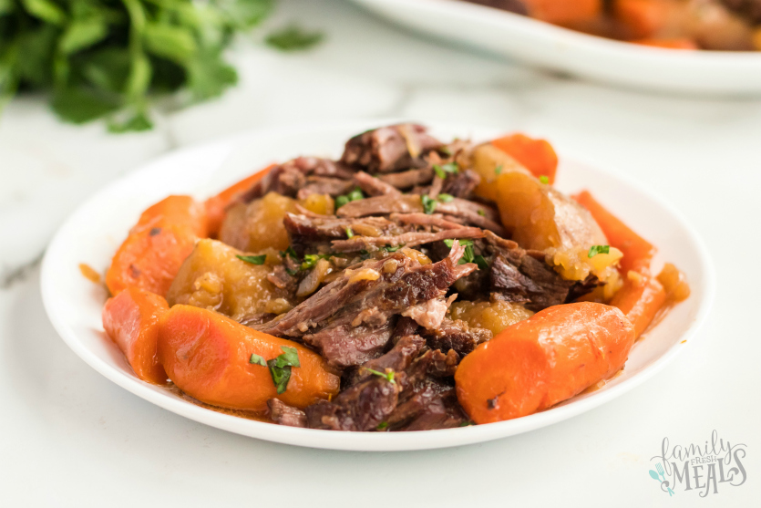 Instant Pot Pot Roast Dinner - served on a white plate - Family Fresh Meals