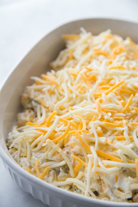 Creamy Fiesta Chicken Bake - Creamy mixture and shredded cheese placed on top of chicken