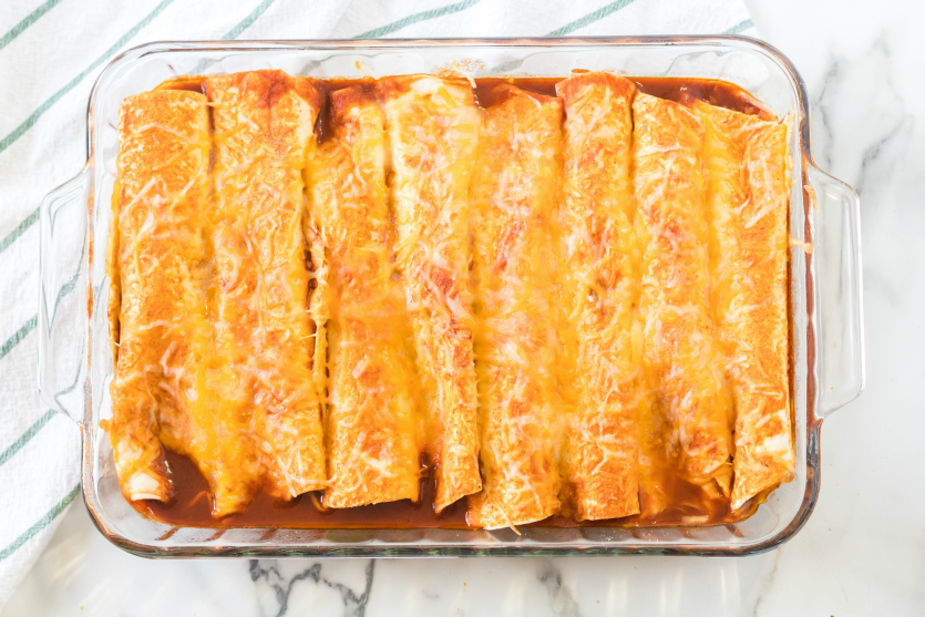 Easy Beef Enchiladas - Cooked enchiladas in baking dish - Family Fresh Meals