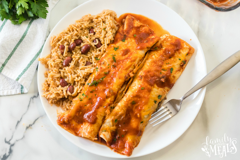 Easy Beef Enchiladas - served on a white plate - Family Fresh Meals