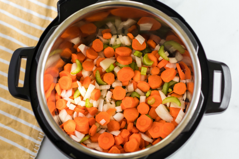 Instant Pot Chicken Noodle Soup - Chopped veggies in instant pot