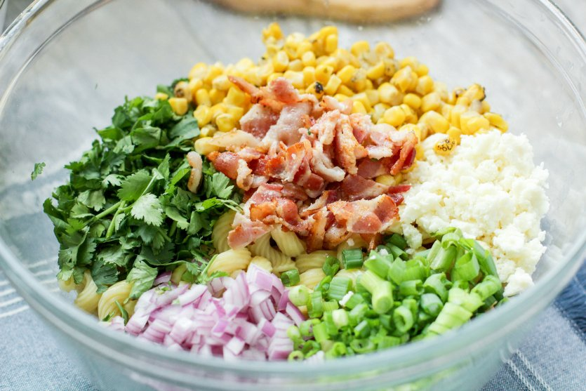 Mexican Street Corn Pasta Salad - salad ingredients in a large mixing bowl