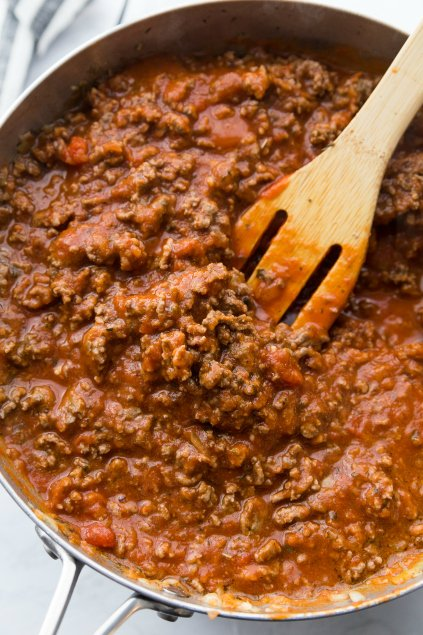 Million Dollar Baked Spaghetti - meat and sauce cooking in pan