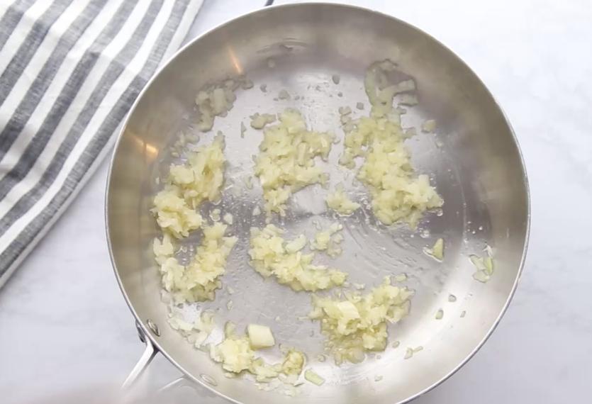Million Dollar Baked Spaghetti - onion cooking in skillet