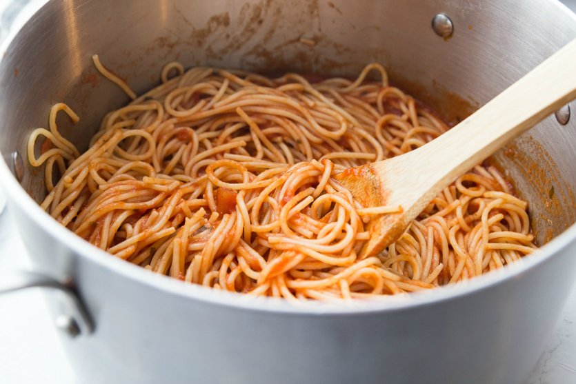 Million Dollar Baked Spaghetti - pasta and sauce mixed together in large cooking pot