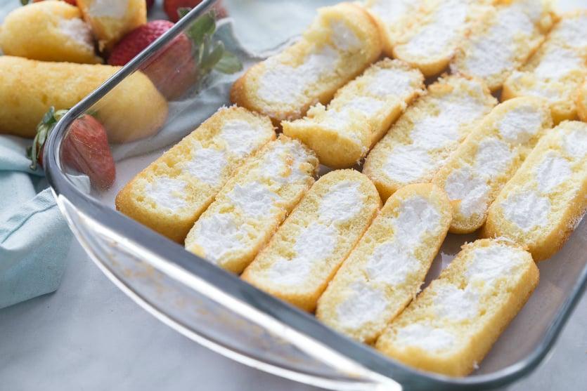 No Bake Strawberry Twinkie Cake - Twinkie halves in baking pan