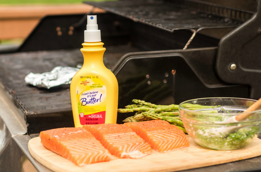 Asparagus Salmon Foil Packets - ICBINB spray, salmon, asparagus on cutting board