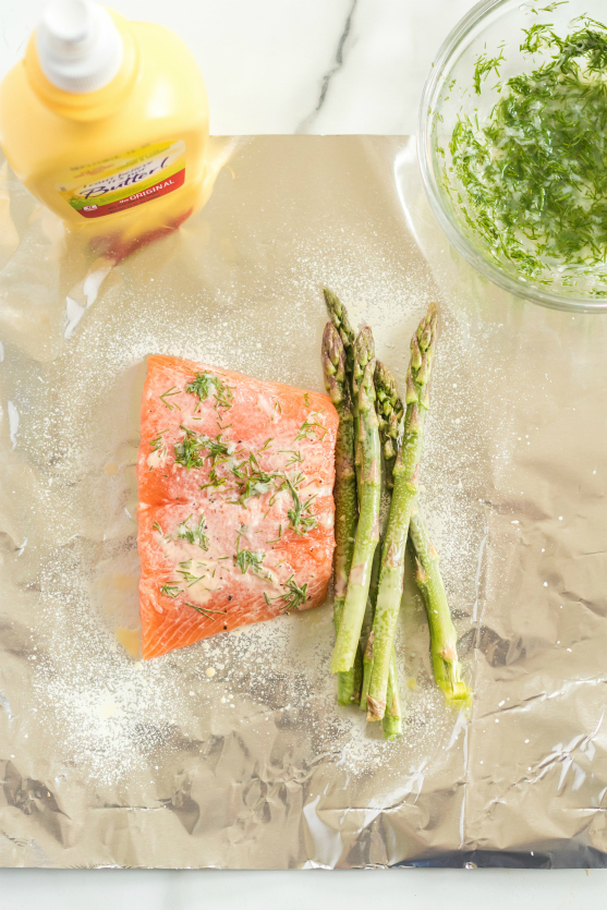 Asparagus Salmon Foil Packets - Salmon, asparagus on foil and sprayed with ICBINB