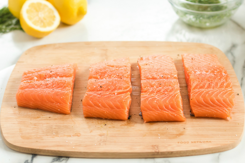 Asparagus Salmon Foil Packets - Sliced salmon on cutting board