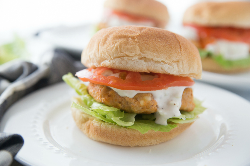 Buffalo Chicken Burgers - Buffalo Chicken burger served on a white plate