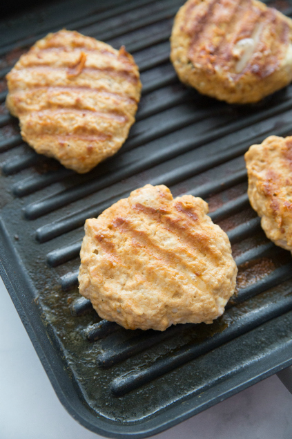 Buffalo Chicken Burgers - Chicken burgers grilling on grill pan