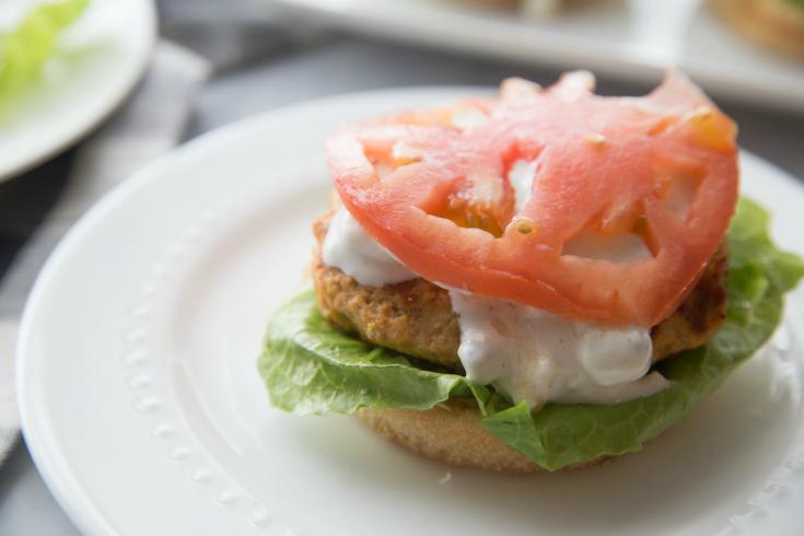 Buffalo Chicken Burgers - Fresh sliced tomato on top of burger