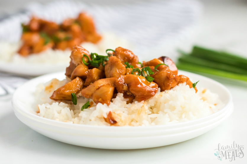Instant Pot Orange Chicken - Two plates of orange chicken served over rice on a white plate