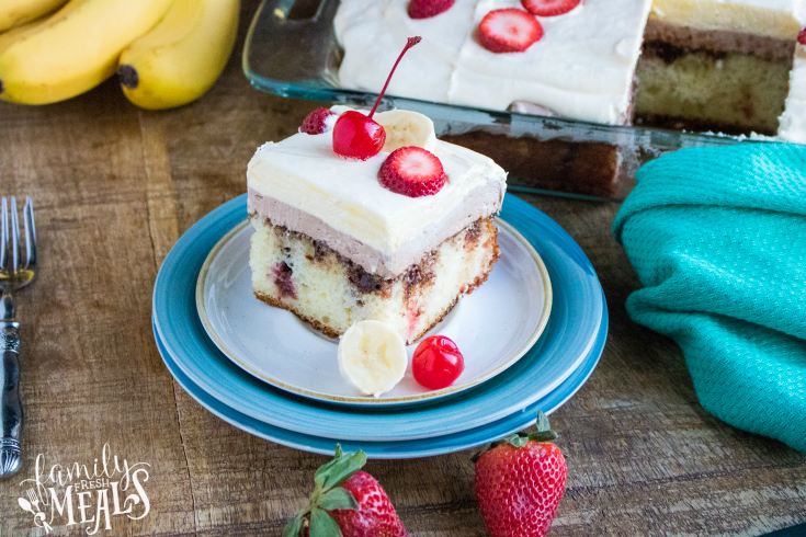 Banana Split Poke Cake - slice of cake served on a plate