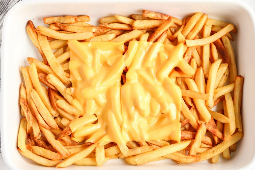 Copycat In N Out Animal Fries - Cheese slices melted on top of cheese
