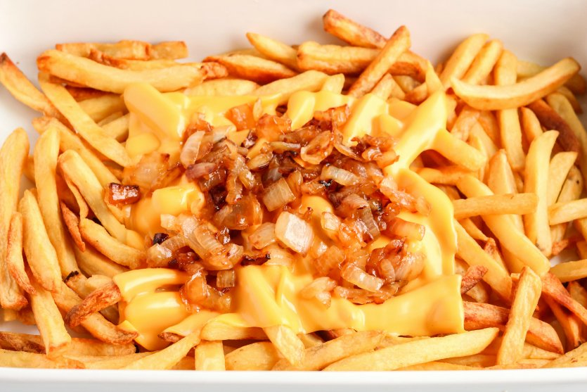 Copycat In N Out Animal Fries - sauteed onions placed on top of melted cheese