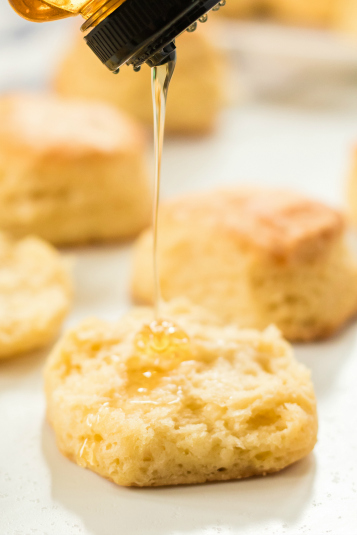 Easy Homemade Biscuits - Honey being drizzled on top of a biscuit