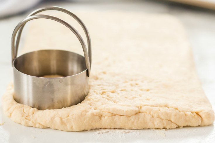 Easy Homemade Biscuits - circle biscuit cutter pushed in to dough