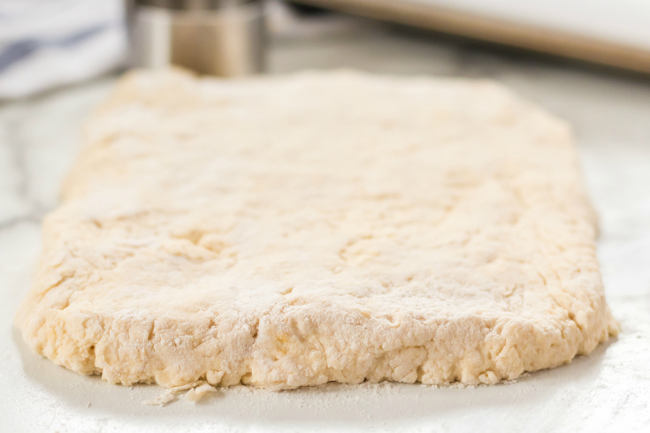 Easy Homemade Biscuits - dough rolled in to a rectangle on floured surface