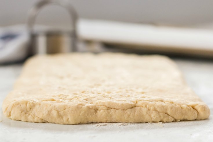 Easy Homemade Biscuits - layered dough rolled back out in to a thick rectangle