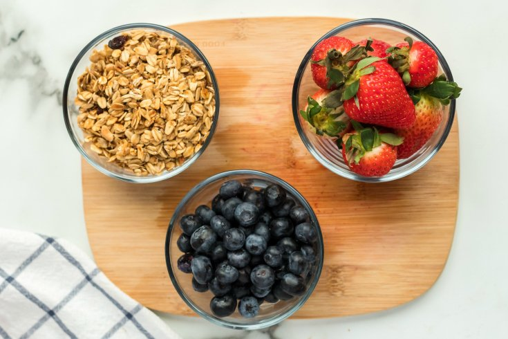 Yogurt Parfait Snack Box - blueberries, strawberries and granola in small bowls