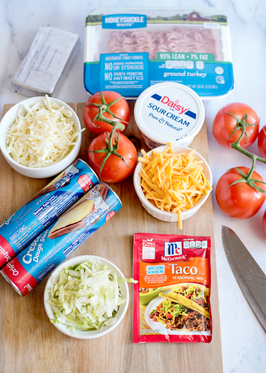 Easy Fiesta Taco Pizza - Ingredients- crescent dough, tomatoes, taco seasoning, shredded cheese, lettuce