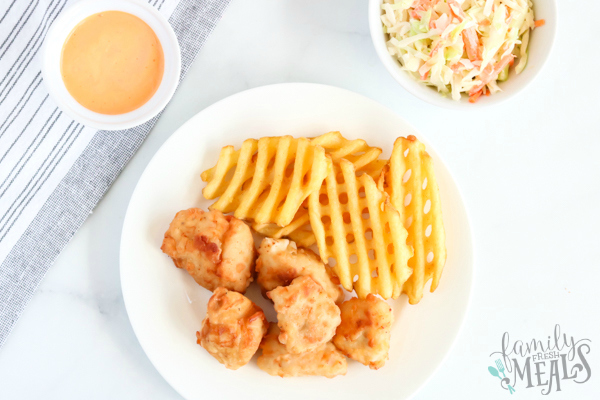 Copycat Chick Fil A Nuggets - nuggets served on a plate with waffle fries