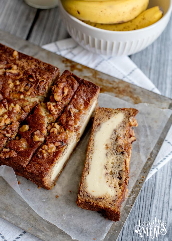 Cream Cheese Banana Bread - Banana bread sliced on a baking sheet