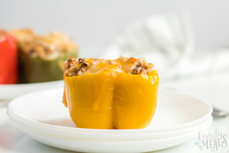 Instant Pot Stuffed Peppers - Yellow stuffed pepper served on a white plate