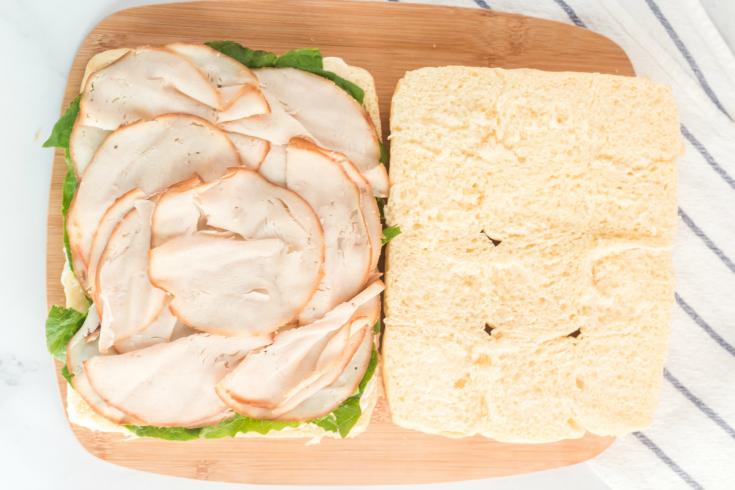 Mini Sliders Lunchbox Idea - Mayo, lettuce and meat added to Hawaiian rolls
