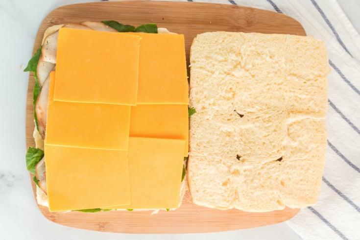 Mini Sliders Lunchbox Idea - sliced cheese added to sandwich